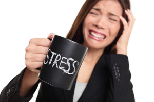Stress at work concept - business woman stressed